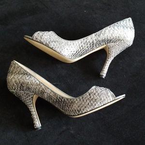 Snakeskin peep toe pumps
